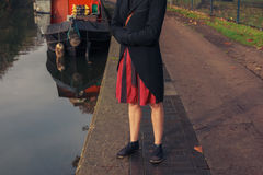 Woman standing by houseboat Stock Photo