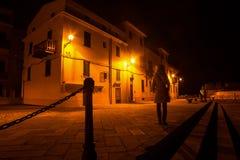 Free Woman Standing In Alghero Promenade At Night Royalty Free Stock Photo - 66044865