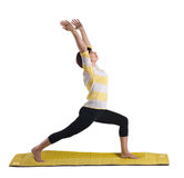 Woman Standing In Yoga Pose Stock Photo