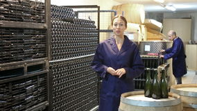 Woman standing indoors on small wine manufacturing stock video footage