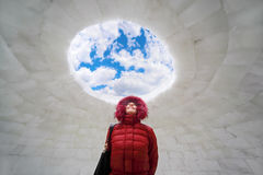 Woman standing inside igloo at winter Royalty Free Stock Photos