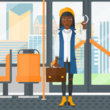Woman standing inside public transport. Royalty Free Stock Photography
