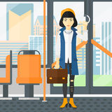 Woman standing inside public transport. Stock Images