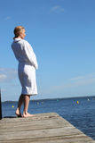 Woman standing on a jetty Stock Images