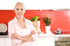 Woman standing in kitchen Royalty Free Stock Photo