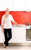 Woman standing in the kitchen Stock Image