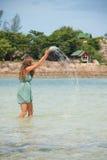 Woman standing knee-deep in water Stock Image
