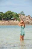 Woman standing knee-deep in water Stock Photo
