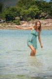 Woman standing knee-deep in water Stock Photos