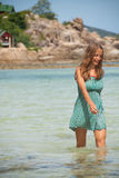 Woman standing knee-deep in water Royalty Free Stock Photo