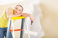 Woman standing on ladder Stock Photos
