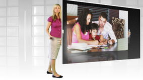 Woman standing before large TV screen stock footage
