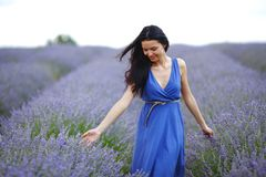 Woman standing on a lavender field Stock Images