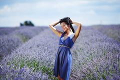 Woman standing on a lavender field Stock Photos