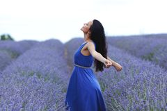 Woman standing on a lavender field Royalty Free Stock Photography