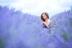 Woman standing on a lavender field Royalty Free Stock Image