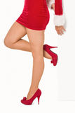 Woman standing with leg raised. On white background Royalty Free Stock Photo