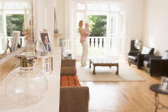 Woman standing in living room holding baby Royalty Free Stock Photo