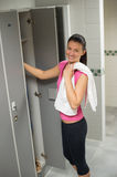 Woman standing by locker in changing room Royalty Free Stock Photos