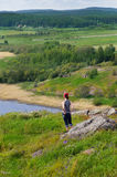 Woman standing and looking on the landscape Stock Image