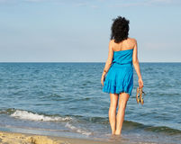 Woman standing looking over ocean Royalty Free Stock Images