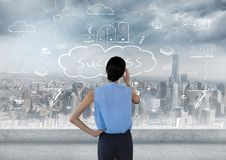Woman standing looking at success doodle over city. Digital composite of Woman standing looking at success doodle over city Royalty Free Stock Photo