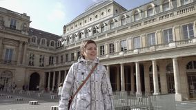Woman standing in Louvre Palace courtyard stock video footage