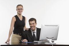 Woman standing beside man Stock Photography