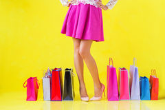 Woman standing with many shopping bags on  the ground Stock Images