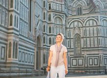 Woman standing with map in florence, italy Stock Photo