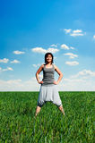 Woman standing at the meadow Stock Image
