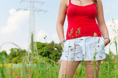 Woman standing in meadow or field Stock Images