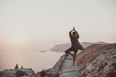 Woman standing and meditating in Monolithos, Rhodes, Greece stock photos