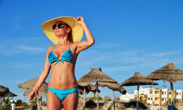 Woman standing on the mediterranean beach on hot summer day Royalty Free Stock Photography