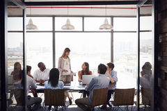 Woman standing at a meeting in a business boardroom Royalty Free Stock Photo