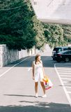 Woman Standing in the middle of the Road Stock Photos
