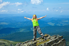 Woman standing on  mountain peak Royalty Free Stock Photos
