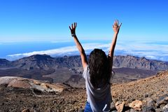 Woman Standing on Mountain While Raising Her Hands Stock Photos