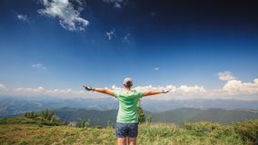 Woman standing on a mountain top Stock Photos