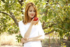 Woman standing near the apple tree. Stock Photography