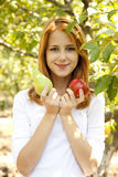 Woman standing near the apple tree. Royalty Free Stock Photos