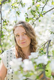 Woman standing near the apple tree Stock Photos