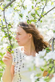 woman standing near the apple tree Royalty Free Stock Photography