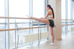 Woman standing near barre in fitness center Royalty Free Stock Image