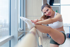 Woman standing near barre in fitness center Royalty Free Stock Photo
