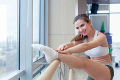 Woman standing near barre in fitness center Royalty Free Stock Images
