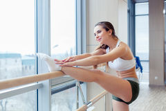 Woman standing near barre in fitness center Stock Image