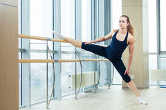 Woman standing near barre in fitness center Royalty Free Stock Photography