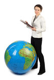 Woman standing near big inflatable globe Royalty Free Stock Images