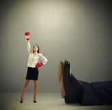 Woman standing near big legs Royalty Free Stock Images